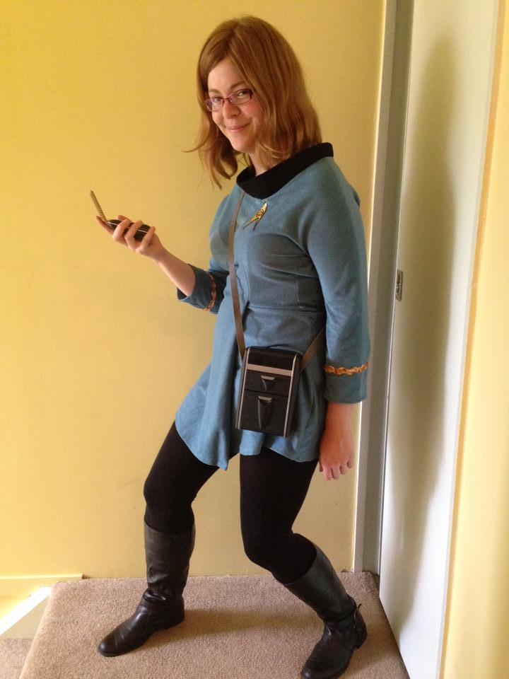 Jarrah inside in the TOS uniform with tricorder and communicator