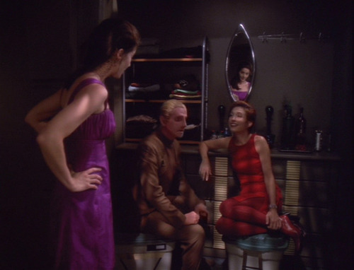 Dax in her party dress finds Odo and Kira talking in her closet