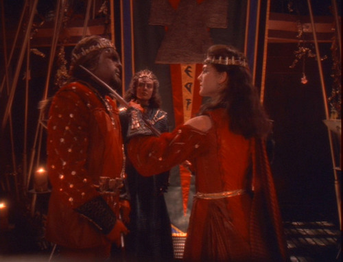 Scene from wedding ceremony where Jadzia holds a bat'leth to Worf's throat