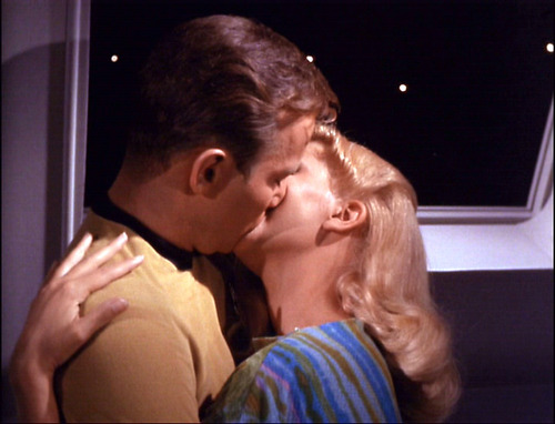 Lenore and Kirk kiss