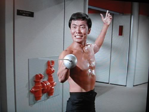 Sulu shirtless with a fencing sword