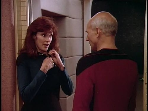 Crusher starts to undo her uniform for Picard
