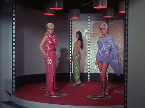 The three women on the transporter pad