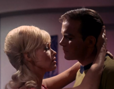 Eve embraces Kirk