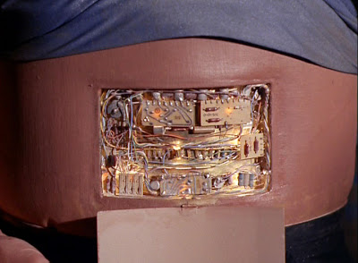 A panel hiding machinery in Norman's abdomen