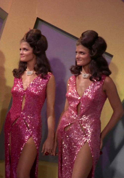 Two android twins in pink sequin dresses