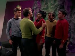 Kirk holds Uhura by the shoulders
