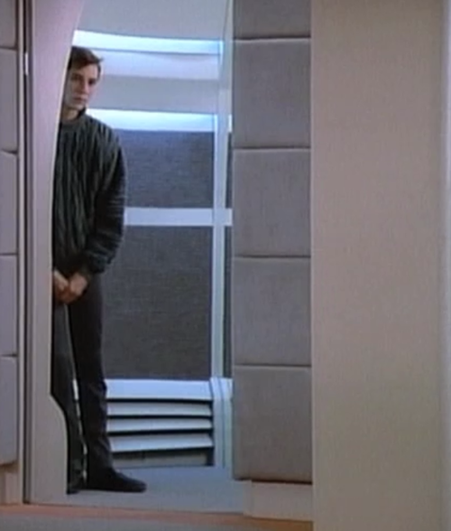 Wesley Crusher peers out of the turbolift.