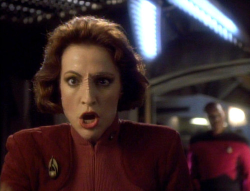Kira yelling at a viewscreen as Sisko walks in behind her