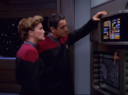 Janeway and Chakotay examine a computer terminal