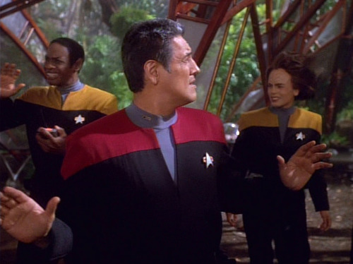 Chakotay holds up his hands