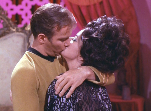 Sylvia and Kirk kiss
