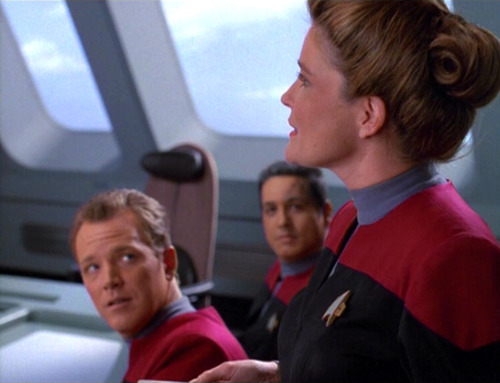 Janeway talks to her senior staff in the conference room