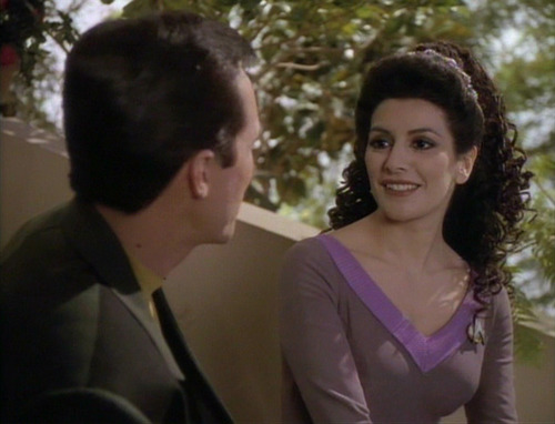 Troi smiles at Aaron