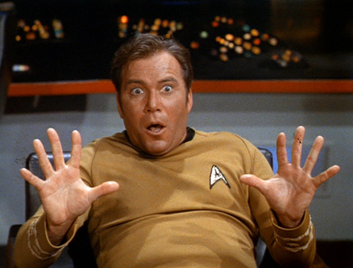 Kirk, scared, holds his hands up