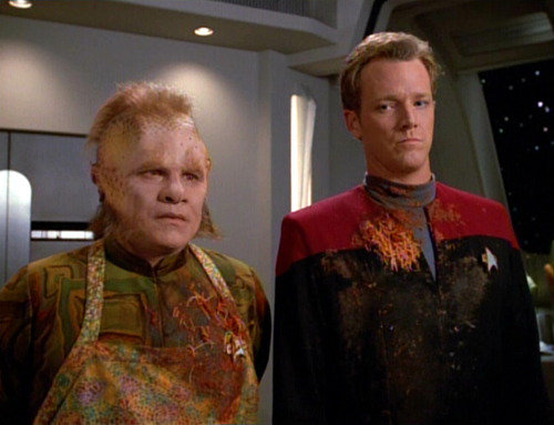 Paris and Neelix report to Janeway post-food fight