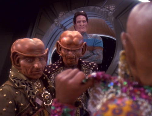Nilva and Brunt look at Quark's open shirt