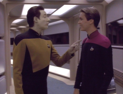 Data talks to Wesley in the corridor