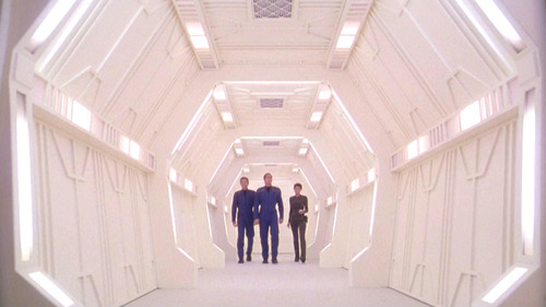 Shot of Archer, Trip and T'Pol in alien station hall