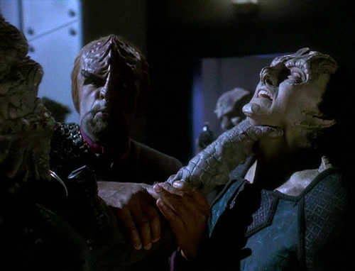 A Jem Hadar chokes Garak while Worf tries to intervene