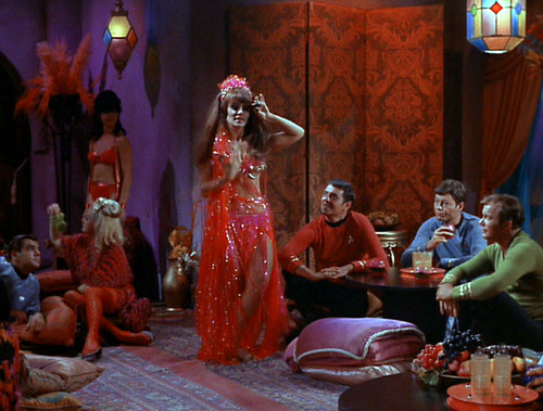 Belly dancer performs as Scotty, McCoy and Kirk watch