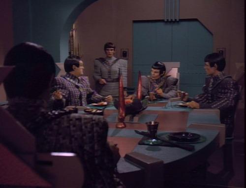 Troi arrives at the Romulan officers' dinner