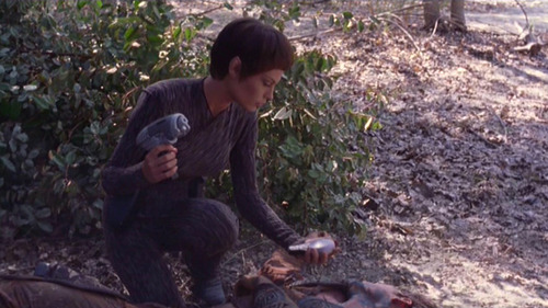 T'Pol scans a presumed alien lying in the dirt