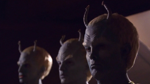Shran and two other Andorians stand partly shadowed
