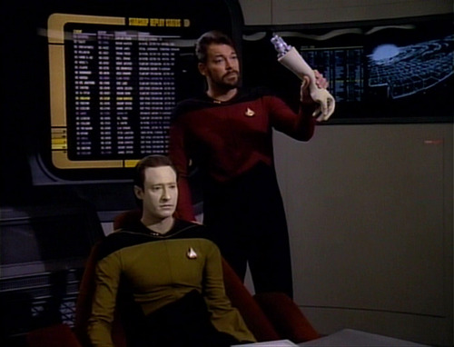 Riker holds up Data's arm