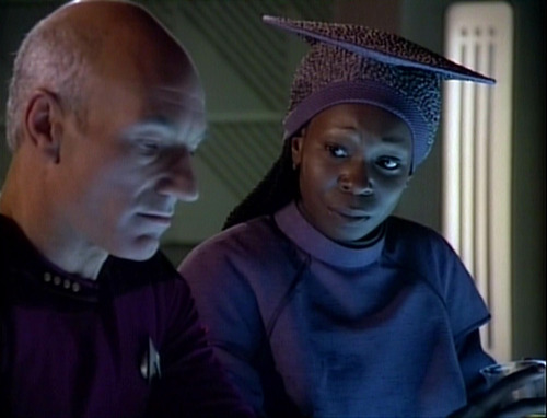 Guinan talks to Picard in Ten Forward