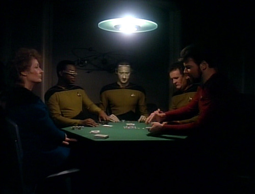 The crew plays poker