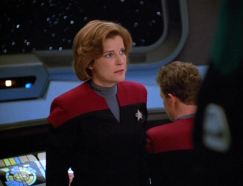 Janeway looks with disappointment at The Doctor