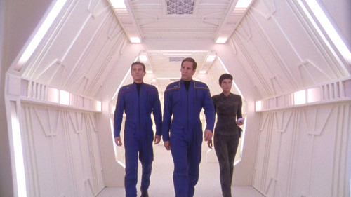 Trip, Archer and T'Pol walk down the station hall