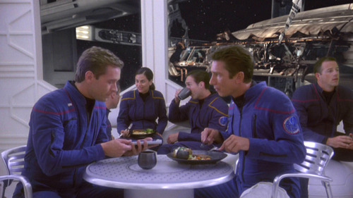 Trip and Reed eat in the futuristic cafeteria