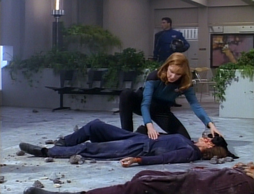 Crusher crouches over the body of a fallen woman.