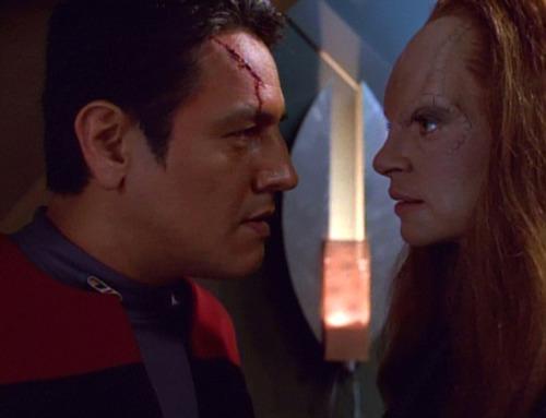 Seska touches Chakotay's bleeding face