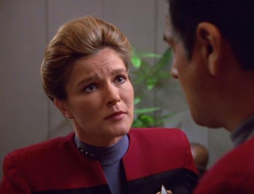 Janeway looks sympathetically at Chakotay