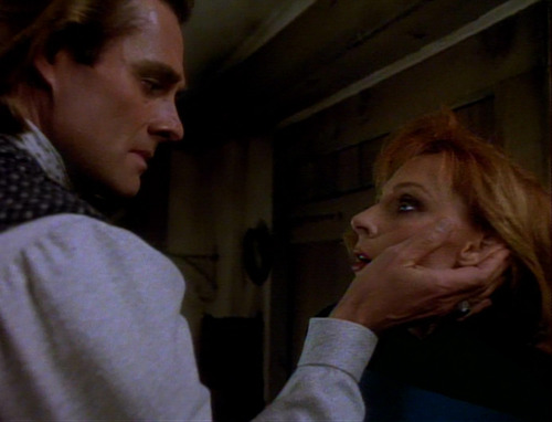 Ronin caresses Beverly's face