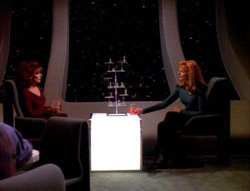 Troi and Crusher talk in Ten Forward