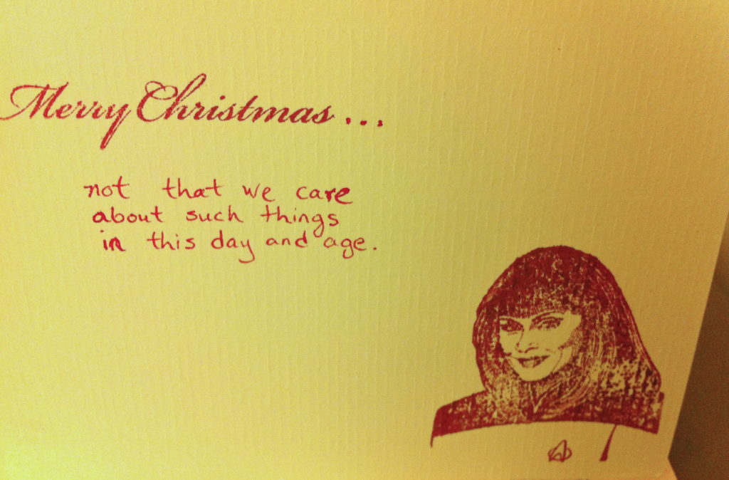 "Card with rubber stamp of Dr. Crusher and ""Merry Christmas...not that we care about such things in this day and age"""