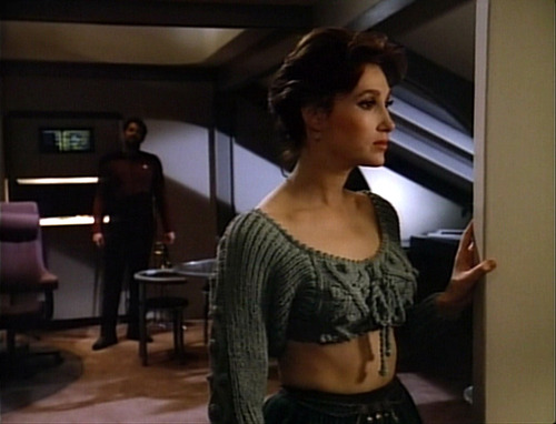 Brenna in her crop top sweater in Riker's quarters