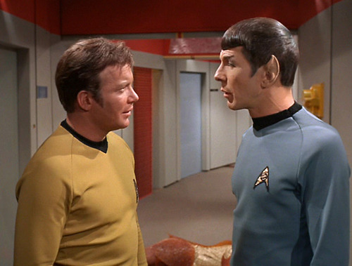 Kirk and Spock talk in the corridor