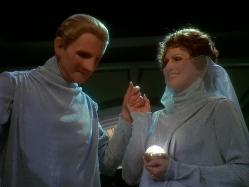 Odo and Lwaxana in their wedding clothes