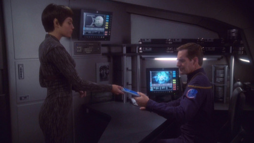 T'Pol hands a PADD to Archer