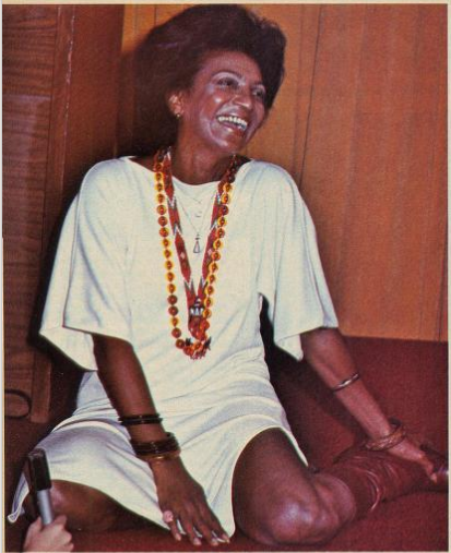 Nichelle Nichols in white shirt dress and colourful beads, 1976