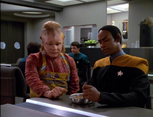Neelix and Tuvok talk in the mess hall about fatherhood