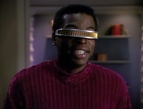 Geordi talks excitedly at dinner