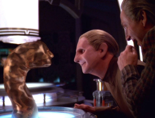 Odo looks with pride at his changeling baby making a face