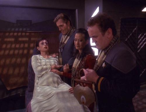 Shakaar, Keiko and Miles at Kira's bedside