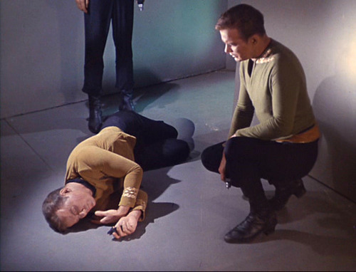 Kirk looks at his other half lying on the floor